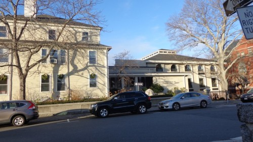 "Here is The Saunders house as it stands today with the 1913 stack section bridging the gap between the old Saunders house and the 1976 contemporary wing designed by Don Monell. The roofline of the newest part reflects the hipped roof of the Saunders house. Each section is proportioned not to compete with the Saunders house and not to look like ""the tail wagging the dog"". The position of the Saunders house is respected by the Monell building P. Fish photo"